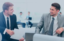Image of business partners discussing documents. Business people Having Meeting Around Table In Modern Office Stock Image
