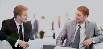 Image of business partners discussing documents and ideas at mee. Business people Having Meeting Around Table In Modern Office Royalty Free Stock Photo