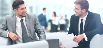 Image of business partners discussing documents and ideas at mee. Business people Having Meeting Around Table In Modern Office Royalty Free Stock Photos