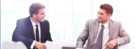 Image of business partners discussing documents and ideas at mee. Business people Having Meeting Around Table In Modern Office Royalty Free Stock Images