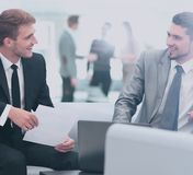 Image of business partners discussing documents and ideas at mee. Business people Having Meeting Around Table In Modern Office Stock Photography