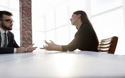 Business people Having Meeting Around Table In Modern Office. Shot of two businesspeople meeting in lobby area of modern office Stock Image