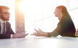 Business people Having Meeting Around Table In Modern Office. Shot of two businesspeople meeting in lobby area of modern office Royalty Free Stock Photography