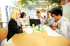 Business people having meeting around table Stock Photo