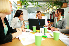 Business people having meeting around table Royalty Free Stock Image