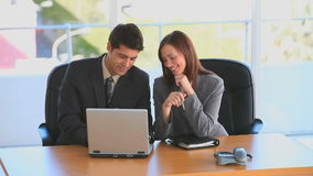 Business people having a meeting. At a desk stock footage