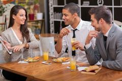 Group of young Businesspeople enjoy in lunch at restaurant Royalty Free Stock Image