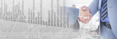 Business people having a meeting with financial figures charts transition effect. Digital composite of Business people having a meeting with financial figures Stock Image