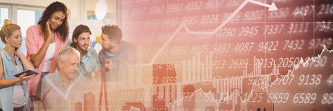Business people having a meeting with financial numbers and figures transition effect Stock Photo