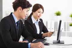 Business people Having Meeting and looking the computer Stock Images