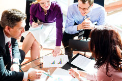 Business people having meeting in office. Business people having meeting or workshop in office checking profit growth graph and documents stock photography