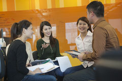 Business People Having Meeting in the Office, Smiling Stock Images