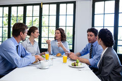 Business people having a meeting in restaurant Stock Photos