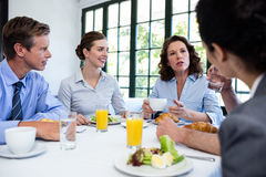 Business people having a meeting in restaurant Royalty Free Stock Image