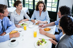 Business people having a meeting in restaurant Stock Images