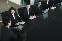 Business people having meeting, sitting at conference table royalty free stock photography