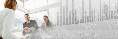 Business people having a meeting with statistic charts financial transition effect. Digital composite of Business people having a meeting with statistic charts Stock Images
