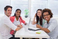 Business people having a meeting together smile at camera Stock Photography