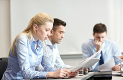 Business people having problem in office. Business, teamwork, people and crisis concept - business team sitting sad and solving problem in office Royalty Free Stock Photos