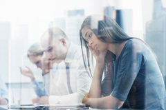 Business people having problem in office. Business, teamwork, people and crisis concept - business team sitting sad and solving problem in office Stock Images