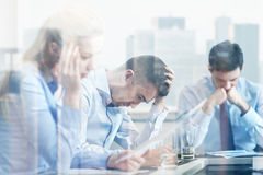 Business people having problem in office. Business, teamwork, people and crisis concept - business team sitting sad and solving problem in office Stock Photo