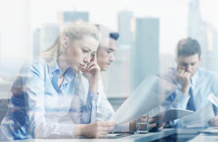 Business people having problem in office. Business, teamwork, people and crisis concept - business team sitting sad and solving problem in office Royalty Free Stock Photography