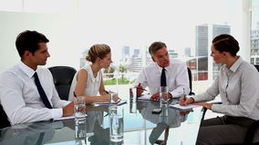 Business people having a serious discussion stock footage