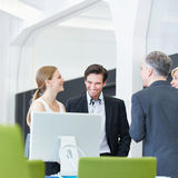 Business people having smalltalk in office Stock Photo