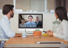 Business people having a video call with colleague on computer. At office Royalty Free Stock Image