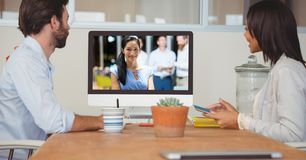 Business people having video conference on computer at office. Digital composite of Business people having video conference on computer at office Stock Images