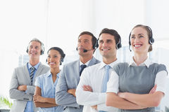 Business people with headsets looking at top Royalty Free Stock Images
