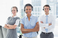 Business people with headsets smiling at camera Royalty Free Stock Images