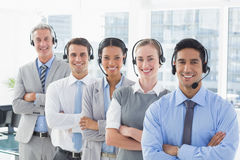 Business people with headsets smiling at camera Stock Photography