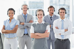 Business people with headsets smiling at camera Stock Images