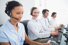 Business people with headsets using computers Stock Photo