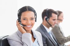 Business people with headsets using computers Royalty Free Stock Photography