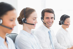 Business people with headsets using computers Royalty Free Stock Photos