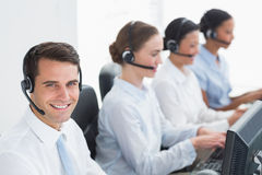 Business people with headsets using computers Stock Photography