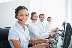 Business people with headsets using computers Royalty Free Stock Photo