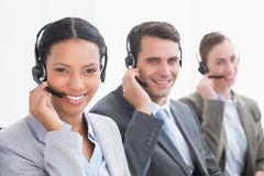 Business people with headsets using computers Royalty Free Stock Image