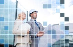 Business people in helmets with blueprint Stock Photography