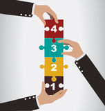 Business people help to assembly vertical puzzle, teamwork conce Royalty Free Stock Photography