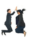Business people high five in the air. Two business people jumping and giving high five in the air isolated on white background Stock Images