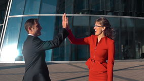 Business people high five outdoor stock video