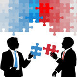 Business people hold collaboration puzzle solution. Two business people hold partnership collaboration puzzle solution Royalty Free Stock Photography