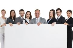 Business people holding big billboard. Group Of Happy Business people holding big billboard studio isolated on white background stock images