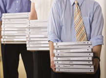 Business People Holding Binders Stock Images