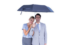 Business people holding a black umbrella Stock Images