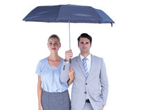 Business people holding a black umbrella Stock Photography