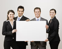 Business people holding blank